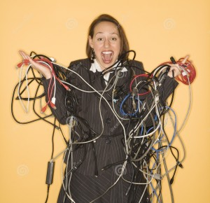 http://www.dreamstime.com/royalty-free-stock-photos-woman-holding-tangled-wires-image2425918